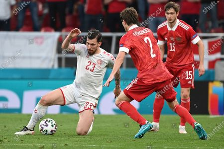 Stock Photo of Denmark's Pierre-Emile Hojbjerg, left, is challenged by Russia's Mario Fernandes during the Euro 2020 soccer championship group B match between Russia and Denmark at the Parken stadium in Copenhagen, Denmark