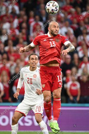 Stock Image of Denmark's Mathias Jorgensen jumps for a header during the Euro 2020 soccer championship group B match between Russia and Denmark at the Parken stadium in Copenhagen, Denmark