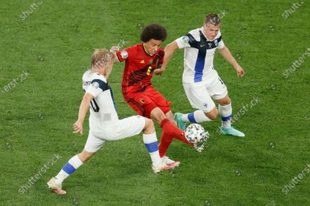 Finnish Joel Pohjanpalo, Belgium's Axel Witsel and Finnish Robin Lod fight for the ball during a soccer game between Finland and Belgium's Red Devils, the third game in the group stage (group B) of the 2020 UEFA European Football Championship, on Monday 21 June 2021 in Saint Petersburg, Russia.