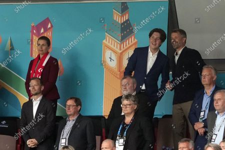 Danish prime minister Mette Frederiksen (left) and prince Christian of Denmark (center) with his father crownprince Frederik of Denmark (right) prior the UEFA EURO 2020 group B preliminary round soccer match between Russia and Denmark in Copenhagen, Denmark, 21 June 2021.