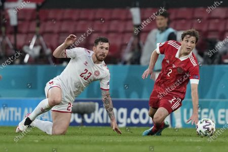 Denmark's Pierre-Emile Hoejbjerg (23) and Russia's Mario Fernandes (2) during the UEFA EURO 2020 group B preliminary round soccer match between Russia and Denmark in Copenhagen, Denmark, 21 June 2021.
