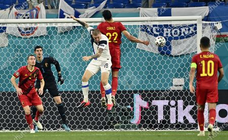 Belgium's Thomas Vermaelen, Belgium's goalkeeper Thibaut Courtois, Finnish Joni Kauko and Belgium's Nacer Chadli pictured in action during a soccer game between Finland and Belgium's Red Devils, the third game in the group stage (group B) of the 2020 UEFA European Football Championship, on Monday 21 June 2021 in Saint Petersburg, Russia.