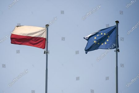 The Polish and EU flag seen raised on the roof of the Ministry of Culture, National Heritage and Sports. Press conference on the adopted national Reading Development Program with the Deputy Prime Minister and Minister of Culture, National Heritage and Sport, Piotr Glinski, and Minister of Education and Science, Przemyslaw Czarnek in attendance.