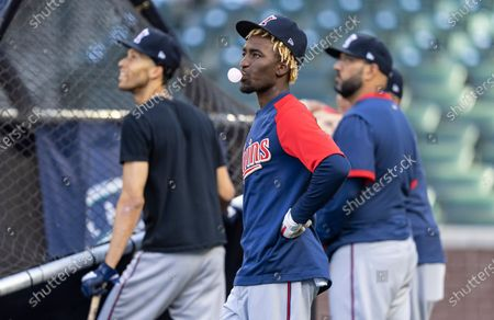 Minnesota Twins' Nick Gordon blows a bubble while watching batting practice before a baseball game against the Seattle Mariners, in Seattle. The Twins won 7-2