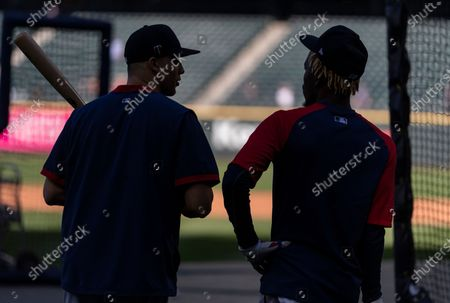 Minnesota Twins' Alex Kirilloff and Nick Gordon are pictured during batting practice before a baseball game against the Seattle Mariners, in Seattle. The Twins won 7-2
