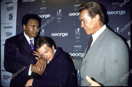 August 3, 2000: (L-R) Muhammad Ali with Michael J. Fox and Arnold Schwarzenegger at GEORGE magazine party.