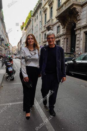 Screenwriter Ippolita Di Majo and Director Mario Martone arrive at Giorgio Armani fashion show during Milan Fashion Week Men's Collection Spring/Summer 2022