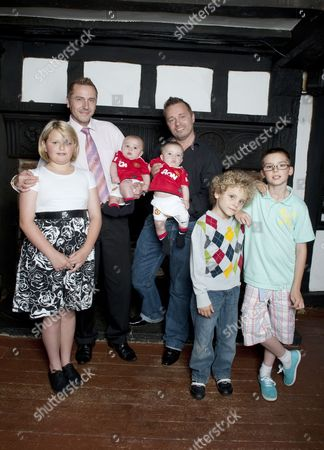 Gay dads Barrie (right) and Tony Drewitt-Barlow with their six-month-old surrogate twins Jasper and Dallas, ten-year-old twins Saffron and Aspen, and Orlando, 6