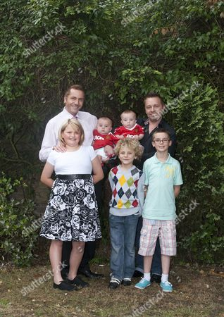 Gay dads Barrie (right) and Tony Drewitt-Barlow with their six month old surrogate twins, Jasper and Dallas, ten-year-old twins Saffron and Aspen, and Orlando, 6