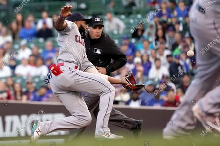Cleveland Indians' Amed Rosario, left, slides and catches a popup by Chicago Cubs' Jason Heyward as second base umpire Quinn Wolcott watches during the second inning of a baseball game, in Chicago