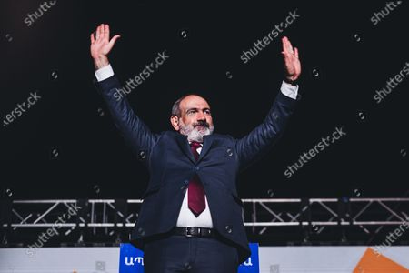 Nikol Pashinyan raises his arms to his supporters in celebration of his victory in the Armenian parliamentary elections in Yerevan's Republic Square.