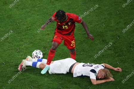 Stock Picture of Jeremy Doku (25) of Belgium and Joel Pohjanpalo (20) of Finland are seen in action during the European championship EURO 2020 between Belgium and Finland at Gazprom Arena. (Final Score; Finland 0:2 Belgium).