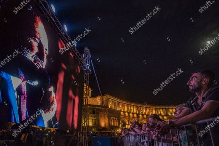 Supporters of Nikol Pashinyan watch him in a huge screen during a speech in the Republic Square in Yerevan celebrating the victory of the Civil Contract party, with Nikol Pashinyan as main candidate for the parliamentary elections in Armenia.
