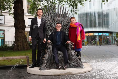 Winter is Coming - A statue of the Iron Throne from Game of Thrones is unveiled in a snow scene in London's Leicester Square. Alex Zane, actor Isaac Hempstead Wright (Bran Stark) and Chief Executive of Heart of London Business Alliance Ros Morgan
