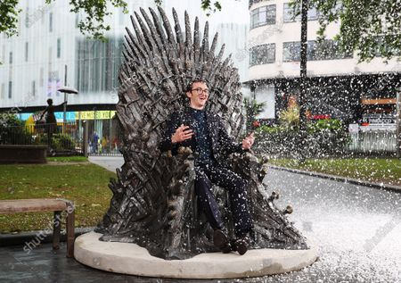 Winter is Coming - A statue of the Iron Throne from Game of Thrones is unveiled in a snow scene in London's Leicester Square. Actor Isaac Hempstead Wright (Bran Stark)
