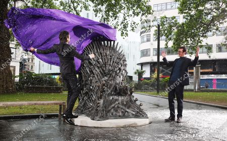 Winter is Coming - A statue of the Iron Throne from Game of Thrones is unveiled in a snow scene in London's Leicester Square. Alex Zane and British actor Isaac Hempstead Wright (Bran Stark)