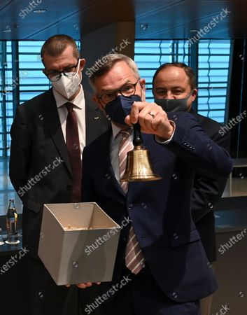 European Minister of State at the Federal Foreign Office Michael Roth holds a bell prior to a General Affairs meeting in Luxembourg, 22 June 2021.