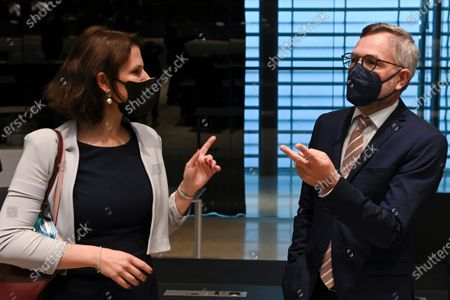 Austrian Minister for European Affairs Karoline Edtstadler (L) talks with European Minister of State at the Federal Foreign Office Michael Roth prior to a General Affairs meeting in Luxembourg, 22 June 2021.