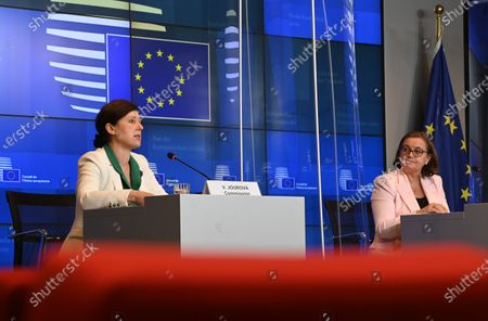 European Commission vice-president in charge for Values and Transparency Vera Jourova (L) and Portuguese Secretary of State of European Affairs and President of Council Ana Paula Zacarias (R) give a press conference during a General Affairs Council in Luxembourg, 22 June 2021.
