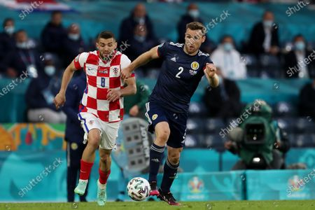 Mateo Kovacic of Croatia and Stephen O'Donnell of Scotland