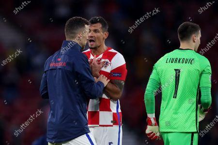 Ivan Perisic and Dejan Lovren of Croatia exchange words at full time