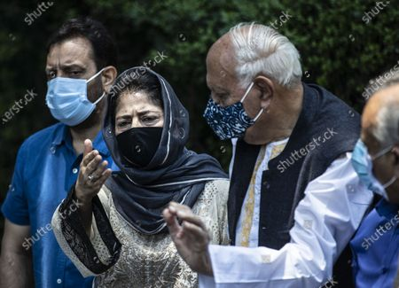 National Conference (NC) President Farooq Abdullah, third left and Peoples Democratic Party (PDP) President Mehbooba Mufti, second left, gesture during a joint press conference of People's Alliance for Gupkar Declaration (PAGD) in Srinagar, Indian controlled Kashmir