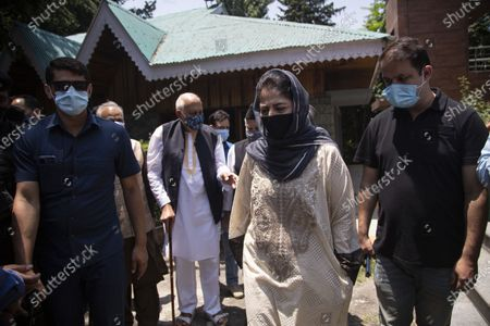 National Conference (NC) President Farooq Abdullah, third left and Peoples Democratic Party (PDP) President Mehbooba Mufti, second right, leave after a joint press conference of People's Alliance for Gupkar Declaration (PAGD) in Srinagar, Indian controlled Kashmir