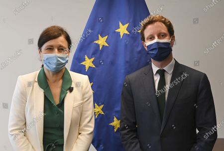 European Commissioner for Values and Transparency Vera Jourova, left, and French European Affairs Minister Clement Beaune pose for a photo before their meeting during a European general affairs ministers meeting at the European Council building in Luxembourg
