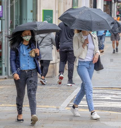 Shoppers and commuters brave the rain this morning in Chelsea, southwest London as the washout summer weather continues. However, forecasters predict a warmer and dryer few days ahead with temperatures reaching around 21c for London and the South East. Today, Health Secretary Matt Hancock announced that Brits will be free from lockdown by July 19 2021 and doubled vaccinated Brits could be exempted from travel quarantine.