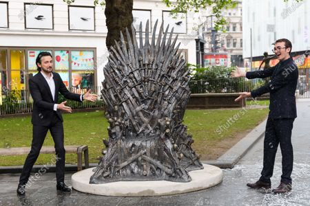 British television presenter Alex Zane (L) and British actor Isaac Hempstead Wright (R) attend the Game Of Thrones Iron Statue unveiling photocall in Leicester Square, London, Britain, 22 June 2021. The statue marks the tenth anniversary of the Game of Thrones and is the final statue unveiled as part of Leicester Square's 'Scenes in the Square'.