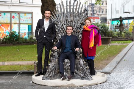 (L-R) British television presenter Alex Zane, British actor Isaac Hempstead Wright and Chief Executive of Heart of London Business Alliance, Ros Morgan during the Game Of Thrones Iron Statue unveiling photocall in Leicester Square, London, Britain, 22 June 2021. The Iron Throne statue marks the tenth anniversary of the Game of Thrones and is the final statue unveiled as part of Leicester Square's 'Scenes in the Square'.