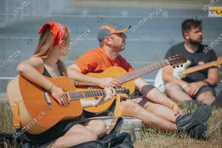 Stock Photo of A mass gathering of guitarists in Wroclaw, Poland, on June 19, 2021. Thousands of guitarists played together. This time, the 18th edition of the Guitar World Record was held at the Pergola in Wroclaw.