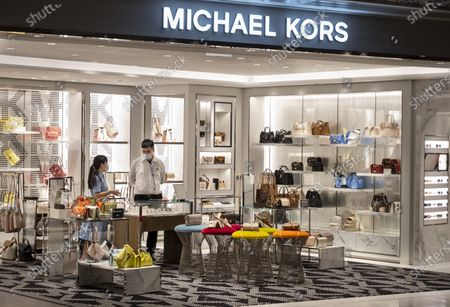 Stock Photo of American clothing fashion store brand Michael Kors (MK) logo seen in Hong Kong.