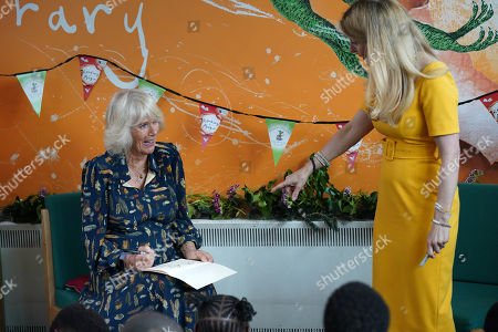 Stock Picture of Camilla Duchess of Cornwall, Patron of BookTrust, takes part in a drawing class during her visit to Griffin Primary School, Nine Elms, London, with Waterstones Children's Laureate, Cressida Cowell (right) to open the new 'Life-changing Library'.