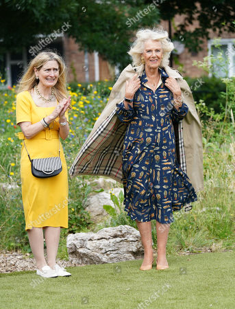 Stock Image of Camilla Duchess of Cornwall, Patron of BookTrust, during her visit to Griffin Primary School in Nine Elms, London, with Waterstones Children's Laureate, Cressida Cowell (left) to open the new 'Life-changing Library'.