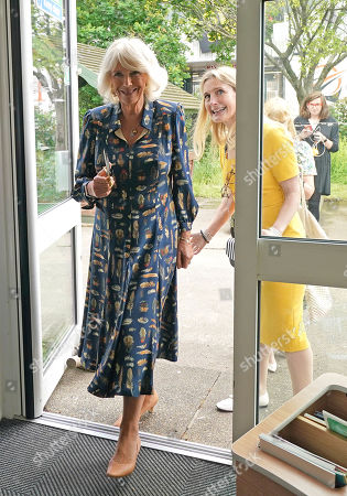 Camilla Duchess of Cornwall, Patron of BookTrust, during her visit to Griffin Primary School in Nine Elms, London, with Waterstones Children's Laureate, Cressida Cowell (right) to open the new 'Life-changing Library'.