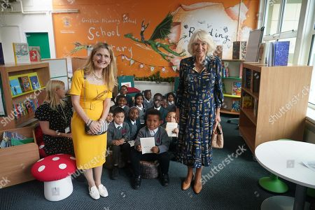 Camilla Duchess of Cornwall, Patron of BookTrust, during her visit to Griffin Primary School in Nine Elms, London, with Waterstones Children's Laureate, Cressida Cowell (left) to open the new 'Life-changing Library'.
