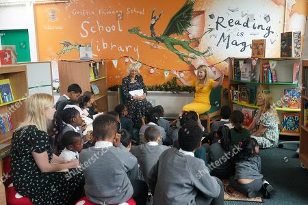 Camilla Duchess of Cornwall, Patron of BookTrust, during her visit to Griffin Primary School, Nine Elms, London, with Waterstones Children's Laureate, Cressida Cowell (right) to open the new 'Life-changing Library'.