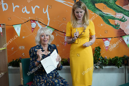 Camilla Duchess of Cornwall, Patron of BookTrust, takes part in a drawing class during her visit to Griffin Primary School, Nine Elms, London, with Waterstones Children's Laureate, Cressida Cowell (right) to open the new 'Life-changing Library'.