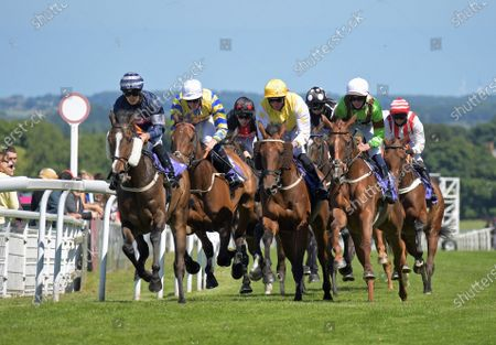 Second from left is EDGAR ALLAN POE with Sam James passing winning post on 1st circuit prior to winning Clearanswer call Centre Handicap Stakes at Beverley