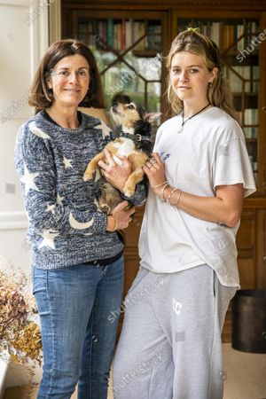 Stock Image of Reunited with Crumpet, Elektra, and her Mother, Sarah.  A family left devastated when their puppy went missing are shocked to have been reunited with her - more than 11 years later.  Sarah Covell and her two young daughters were heartbroken when their three-month-old Jack Russell called Crumpet went missing from their back garden in 2010.  They spent weeks looking for her before giving up hope of ever seeing her again.  But he family received a phone call out of the blue to say their microchipped dog had been found over 30 miles away.