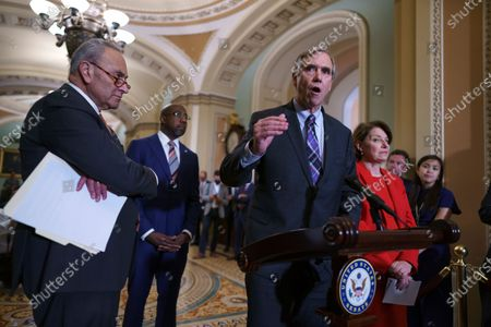 From left, Senate Majority Leader Chuck Schumer, D-N.Y., Sen. Raphael Warnock, D-Ga., Sen. Jeff Merkley, D-Ore., and Sen. Amy Klobuchar, D-Minn., meet with reporters before a key test vote on the For the People Act, a sweeping bill that would overhaul the election system and voting rights, at the Capitol in Washington, . The bill is a top priority for Democrats seeking to ensure access to the polls and mail in ballots, but it is opposed by Republicans as a federal overreach