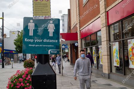 A Keep your distance sign in Slough High Street. Due to the spread of the Covid-19 Indian Variant surge testing is taking place across Slough