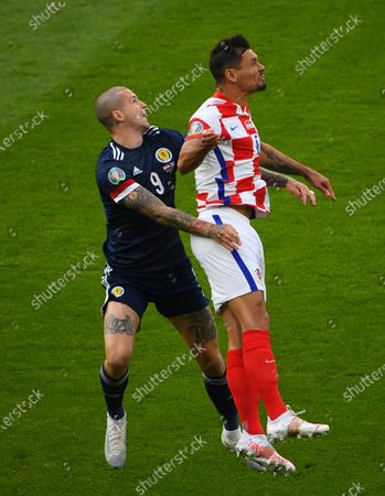 Lyndon Dykes (L) of Scotland in action against Dejan Lovren of Croatia during the UEFA EURO 2020 group D preliminary round soccer match between Croatia and Scotland in Glasgow, Britain, 22 June 2021.