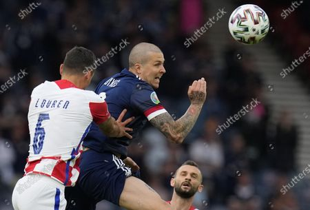 Lyndon Dykes (R) of Scotland in action against Dejan Lovren of Croatia during the UEFA EURO 2020 group D preliminary round soccer match between Croatia and Scotland in Glasgow, Britain, 22 June 2021.