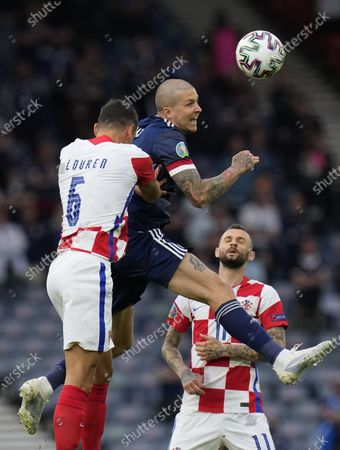 Lyndon Dykes (C) of Scotland in action against Dejan Lovren (L) of Croatia during the UEFA EURO 2020 group D preliminary round soccer match between Croatia and Scotland in Glasgow, Britain, 22 June 2021.