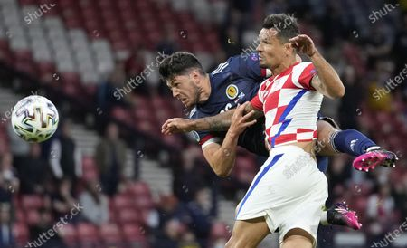 Dejan Lovren of Croatia in action against Scott McKenna (L) of Scotland during the UEFA EURO 2020 group D preliminary round soccer match between Croatia and Scotland in Glasgow, Britain, 22 June 2021.