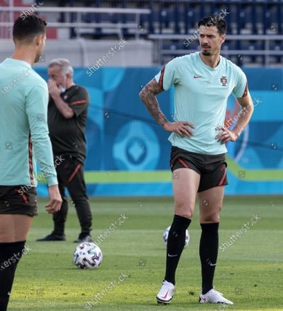 Stock Photo of Jose Fonte (R) of Portugal participates in a training session for the Euro 2020 soccer tournament in Illovszky Rudolf Stadium in Budapest, Hungary, 22 June 2021. Portugal will play against France in the third round of Group F in Budapest on 23 June.