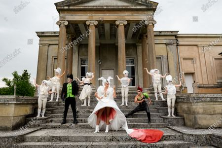 Stock Image of Pictured: The cast of A Midsummer Nightâ€s Dream L/R Anna Munoz, Francesca Pringle, Alexander Chance, Isabel Irvine, Samantha Clarke, May Abercrombie,Chris Darmanin, Daisy Mitchell and Ceferina Penny rehearse on the steps infront of the Orangery, against the dramatic Ionic theatre columns on the southwest corner of The Grange at Northington, a 19th-century country house-mansion in Northington, Hampshire ahead of the start of The Grange Festival.   The Grange Festival, which between June and July hosts opera, theatre and dance amongst the magnificent neoclassical residence which resembles a Greek temple buried in the heart of Hampshire, begins on Thursday 24 June 2021 with Paul Curran's production of A Midsummer Night's Dream.    Auction house Olympia Auctions are hosting three auctions for The Grange Festival, alongside world-famous heritage sites Westminster Abbey and The Wallace Collection in London due to the devastating effects of the coronavirus pandemic. The three auctions are expected to raise over £50,000 in total for the three institutions, with further auctions planned later in the year.