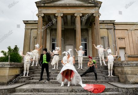 Stock Picture of Pictured: The cast of A Midsummer Nightâ€s Dream L/R Anna Munoz, Francesca Pringle, Alexander Chance, Isabel Irvine, Samantha Clarke, May Abercrombie,Chris Darmanin, Daisy Mitchell and Ceferina Penny rehearse on the steps infront of the Orangery, against the dramatic Ionic theatre columns on the southwest corner of The Grange at Northington, a 19th-century country house-mansion in Northington, Hampshire ahead of the start of The Grange Festival.   The Grange Festival, which between June and July hosts opera, theatre and dance amongst the magnificent neoclassical residence which resembles a Greek temple buried in the heart of Hampshire, begins on Thursday 24 June 2021 with Paul Curran's production of A Midsummer Night's Dream.    Auction house Olympia Auctions are hosting three auctions for The Grange Festival, alongside world-famous heritage sites Westminster Abbey and The Wallace Collection in London due to the devastating effects of the coronavirus pandemic. The three auctions are expected to raise over £50,000 in total for the three institutions, with further auctions planned later in the year.